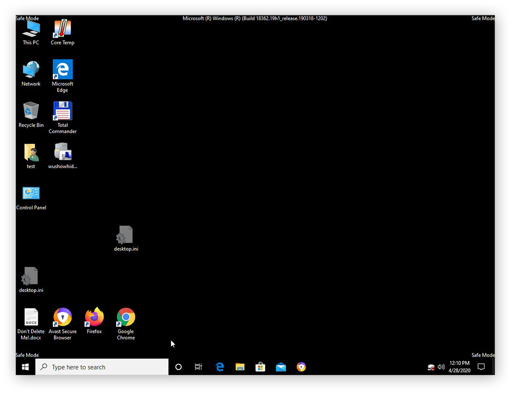 "The desktop of a computer using Windows 10 in Safe Mode, with the phrase ""Safe Mode"" visible in each corner of the screen"