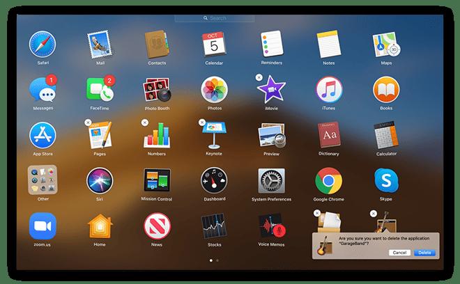 Capture d'écran de la vue Mac Launchpad avec l'application GarageBand prête à être supprimée, avec invite de confirmation.